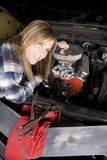 Smiling working on car Stock Image