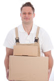 Smiling workman carrying boxes Royalty Free Stock Photos