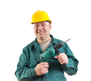 Smiling workman with a drill Royalty Free Stock Photos