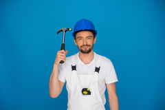 Smiling workman holding up a hammer Royalty Free Stock Image
