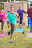 Smiling Workout Instructor. With diverse group outdoors Royalty Free Stock Photos