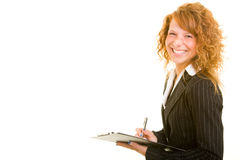 Smiling and writing Royalty Free Stock Photo