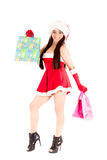 Smiling xmas shopping girl on white background. Royalty Free Stock Photo