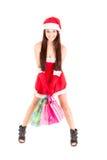Smiling xmas shopping girl on white background. Royalty Free Stock Image