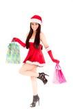 Smiling xmas shopping girl on white background. Royalty Free Stock Images