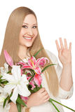 Smiling xxl woman holding flowers Stock Photo