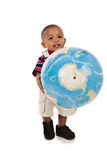Smiling 1-year old baby boy standing holding big globe Royalty Free Stock Photo