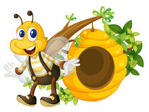 A smiling yellow bee near the beehive Royalty Free Stock Photos