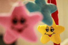 Smiling Yellow, Blue and Pink Stars Royalty Free Stock Photos
