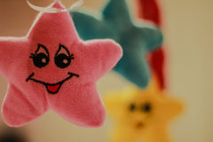 Smiling Yellow, Blue and Pink Stars Stock Photos