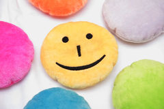 Smiling yellow pillow Stock Photography