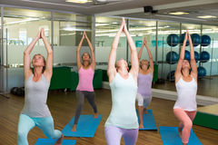 Smiling yoga class in fitness studio Stock Images