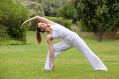 Smiling yoga woman stretching in the park Royalty Free Stock Photography