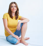 Smiling yong woman sitting on floor Royalty Free Stock Photography