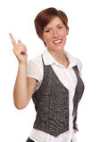 Smiling Young Adult Female Pointing Up and Over Royalty Free Stock Photo