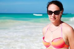 Smiling young adult woman on the beach stock photo