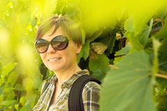 Smiling young adult woman in vineyard Stock Photos
