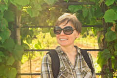 Smiling young adult woman in vineyard Royalty Free Stock Images