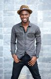 Smiling young african ameircan man with hat Stock Photography