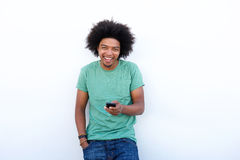 Smiling young african american man with cell phone Stock Photos