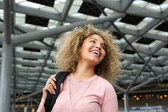 Smiling young african american woman with backpack. Portrait of smiling young african american woman in station with backpack Stock Photos