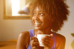Smiling young african american woman with coffee cup. Close up portrait of a smiling young african american woman with coffee cup Stock Image