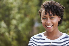 Smiling young African American woman, head and shoulders Stock Photos