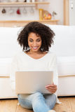 Smiling young African American woman at home Royalty Free Stock Photos