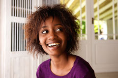 Smiling young african american woman looking away Royalty Free Stock Photo