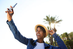 Smiling young african american woman taking selfie outside Stock Images