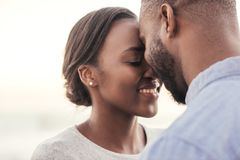 Romantic young African couple enjoying moment together at the beach stock photos