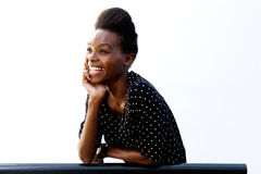 Smiling young african lady leaning on railing Stock Images