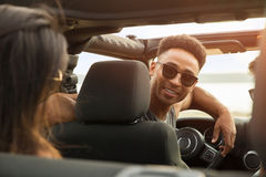 Smiling young african man having fun with his friends Stock Photos