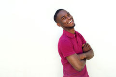 Smiling young african man standing with arms crossed. Portrait of smiling young african man standing with arms crossed Stock Photography