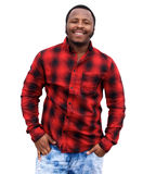 Smiling young african man standing by white background Stock Images