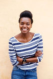 Smiling young african woman with arms crossed Stock Photo