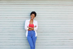 Smiling young african woman with arms crossed Royalty Free Stock Image