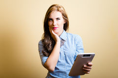Smiling young amazing female with tablet pc Stock Image