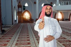 Smiling young arabian man posing inside the mosque Royalty Free Stock Image