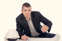 Smiling young architect giving a thumbs up Royalty Free Stock Image