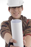 Smiling young architect showing paper roll Stock Photo