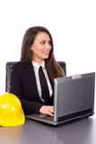 Smiling young architect woman using laptop Royalty Free Stock Images
