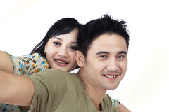 Smiling young asian couple piggyback Royalty Free Stock Image