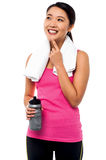 Smiling young asian female thinking and smiling Royalty Free Stock Image