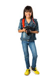 Smiling young asian girl holding photo camera Royalty Free Stock Photo