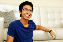 Smiling young asian man at home Stock Photo
