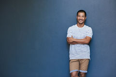 Smiling young Asian man with a laid back attitude royalty free stock photography