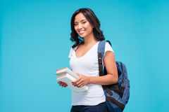 Smiling young asian student girl standing with books royalty free stock images