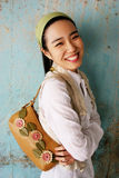 Smiling young Asian woman Stock Photo
