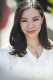 Smiling Young Asian Woman or Businesswoman Royalty Free Stock Photos